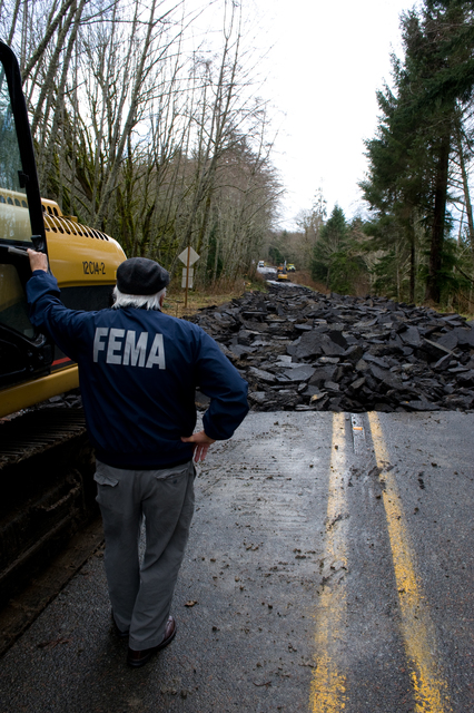 Flooding - Sekiu, Wash. , March 2, 2009 -- FEMA field Public Information Officer (PIO) Ernie Martz surveys damage to State Route 112 along the Strait of Juan De Fuca. Severe flooding from recent storms damaged the highway and cut off transportation to the Makah Indian Reservation.  Adam DuBrowa/FEMA
