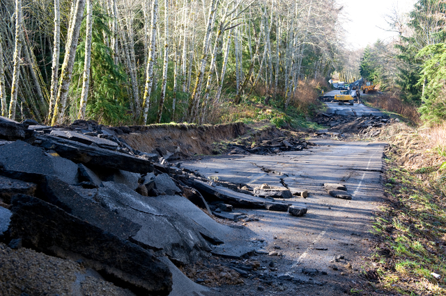 Flooding ^ Severe Storm - Sekiu, Wash. , March 2, 2009 -- Winding along The Straight of Juan De Fuca, State Route 112 suffered severe damage after flooding eroded the highway. WA DOT crews work to repair the roadway after the storms wake and reopen the roadway. Adam DuBrowa/FEMA