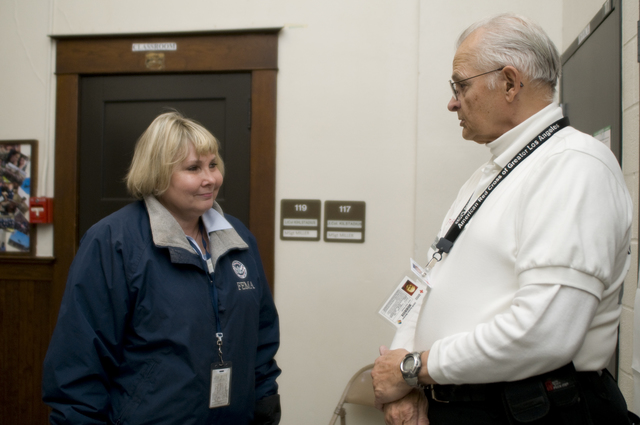 Flooding ^ Severe Storm - Fargo, N. D. , March 27, 2009 -- Fargo, ND March 27,2009  FEMA PIO Susan Soloman talks to Dick Thorpe, the  Red Cross shelter manager in Fargo. FEMA is working with the Red Cross to assist residents who may be affected by flooding. Photo by Patsy Lynch/FEMA