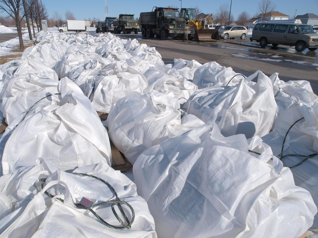 Flooding - Fargo, N. D. , March 28, 2009 -- The ND National Guard stages  sand bag baskets to be used if they need a emergency repair on the dike.  The baskets are lowered into place by Black Hawk helicopter.  Photo; Michael Rieger/FEMA