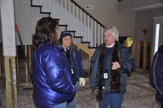 Flooding ^ Winter Storm - Linton, N. D. , April 1, 2009 -- IA PDA teams began work in four counties today after March floods led to a PA declaration.  Darlene Geraets (right) led the team whose tour of Linton included the damaged home of Kathy Kramer, left.  Michael Raphael/FEMA