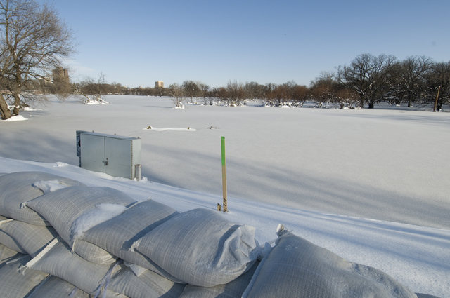 Flooding - Moorhead, Minn. , April 2, 2009 -- A wall of frozen sandbags stands against the flood waters of the Red River. Despite an effort hampering spring blizzard, residents and municipalities built massive sandbag and clay dikes to hold back the water. Mike Moore/FEMA