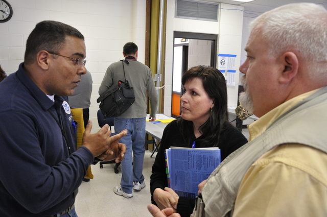 Flooding ^ Winter Storm - Linton, N. D. , April 14, 2009 -- FCO Tito Hernandez discusses newly opened DRC in Linton and its operations with Linton emergency manager Shawna Paul and Greg Wilz, director of the state Division of Homeland Security.  Michael Raphael/FEMA