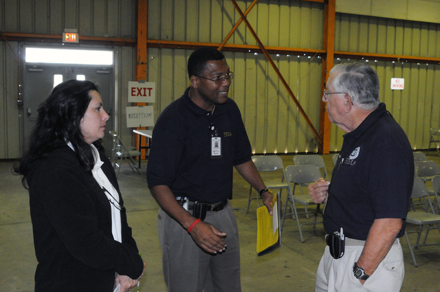 Flooding ^ Severe Storm - Valdosta, Ga. , April 28, 2009 -- At the Lowndes County FEMA/State Disaster Recovery Center(DRC) Serge Phillippeaux, FEMA CR Manager and Annette Robinson CR Specialist, coordinate efforts with FEMA DRC Manager Joe Redmond prior to starting CR outreach in this community.  CR goes door-to-door to locate residents affected by the March severe storms and advise how to get help from FEMA. George Armstrong/FEMA