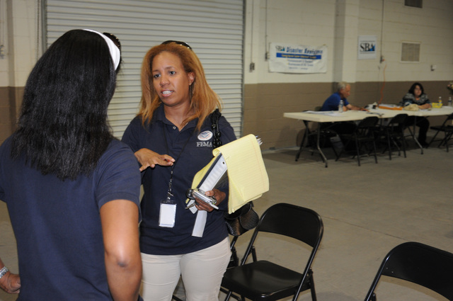Flooding ^ Severe Storm - Marianna, Fla. , May 10, 2009 -- At the Jackson County FEMA/State Disaster Recovery Center(DRC) FEMA PIO Erika Laws confers with State DRC Manager LaDetria Upshaw. FEMA and partners are here in response to recent storms/flooding.  George Armstrong/FEMA