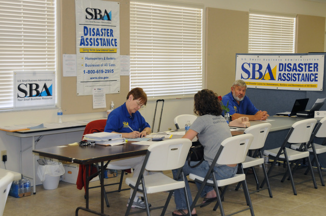 Flooding ^ Severe Storm - Lee, Fla. , May 14, 2009 -- At the Madison County Disaster Recovery Center(DRC) Small Business Administration (SBA) Specialist Janice Cribbs talks with a potential loan applicant as SBA Lead William Tryon is ready for the next interview. FEMA and partners are here due to severe storms/flooding.  George Armstrong/FEMA