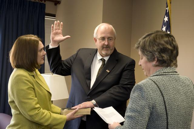 Washington, D. C. , May 19, 2009 --  FEMA Administrator W. Craig Fugate being sworn in at FEMA Headquarters by DHS Secretary Janet Napolitano.  Mrs. Fugate is  holding the bible.  FEMA/Bill Koplitz