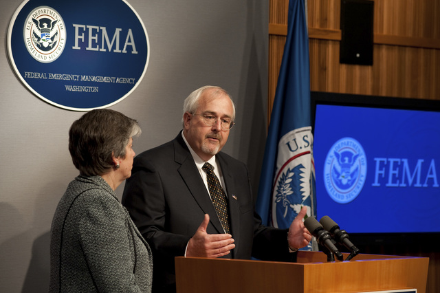 Washington, D. C. , May 19, 2009 -- Newly sworn in FEMA Administrator W. Craig Fugate answers a question from the press at the FEMA Press Briefing room.  DHS Secretary Janet Napolitano is with him at the podium.  FEMA/Bill Koplitz