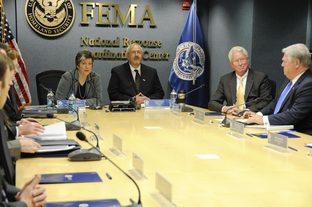 Washington, D. C. , May 19, 2009 -- Video Teleconference at FEMA Headquarters with FEMA Administrator W. Craig Fugate and DHS Secretary Janet Napolitano. To the right Acting Deputy Administrator David Garratt and Mississippi Governor Haley Barbour. FEMA/Bill Koplitz