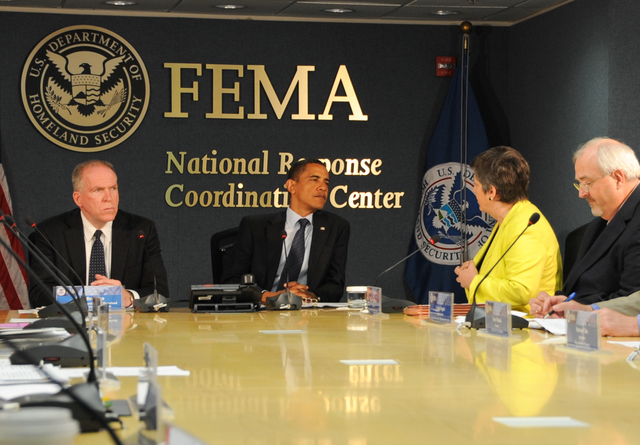 Washington, D. C. , May 29, 2009 -- President Obama visits FEMA headquarters to attend a meeting of the Homeland Security Council, here with (l) John O. Brennan, (far right) FEMA Administrator W. Craig Fugate and DHS Secretary Janet Napolitano (r, yellow jacket). June 1 marks the beginning of hurricane season and Mr. Obama was being briefed by Federal Agencies and Departments that are involved in Hurricane response and recovery. FEMA/Bill Koplitz