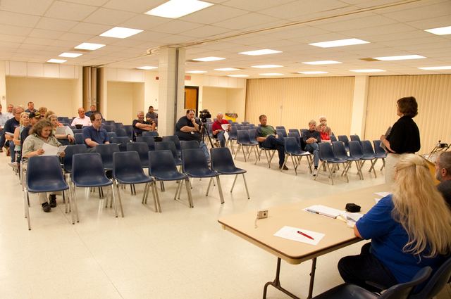 Flooding - Jamestown, N. D. , June 4, 2009 -- FEMA Mitigation Specialist Diane Earl explains mitigation techniques to homeowners at an educational workshop.  FEMA conducts such workshops to help communities minimize damage from future disasters.