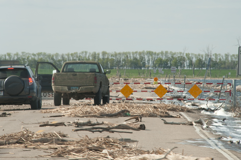 Flooding ^ Severe Storm - Devil's Lake, N. D. , June 5, 2009 -- A  road is covered with debris from Spirit Lake.  The saltwater lake has been steadily rising for the last several years, threatening homes and businesses in the area.  Photograph by Samir Valeja/FEMA