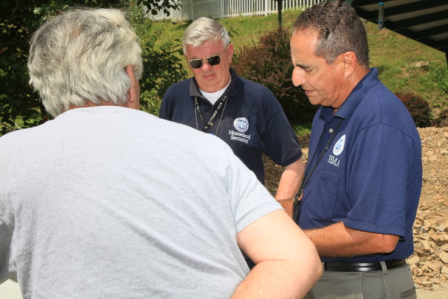 Flooding ^ Mudslide/Landslide ^ Severe Storm - Pikeville, Ky. , June 9, 2009 -- FEMA Community Relations (CR) specialist,  Carlos Galarza and Douglas Parker talk to a resident of Pikeville in Pike County, KY. FEMA goes into neighborhoods to tell residents about federal recovery programs for individuals. Rob Melendez/FEMA
