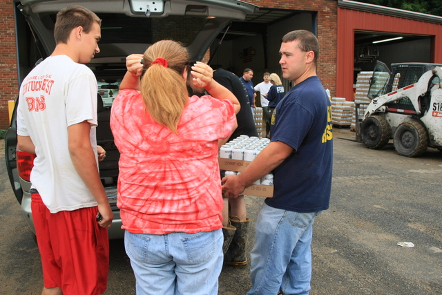 Flooding ^ Mudslide/Landslide ^ Severe Storm - Pike County, Ky. , June 12, 2009 -- Big Creek Volunteer Fire Department Captain Mitch Case, distributes water donated by The Mingo Bottling company to residents affected by a second round of floods in the Sidney area in a month, at their damaged fire station in Pike County, KY. Volunteer agencies are a valuable partners to FEMA during natural disasters. Rob Melendez/FEMA