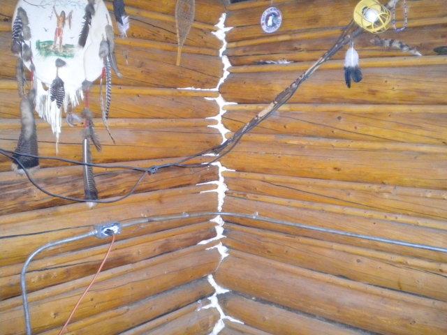 Flooding ^ Winter Storm - Stevens Village, Alaska, August 4, 2009 -- Mennonite Disaster Service volunteers sprayed insulation foam in the corners of this house to help keep it warm during the cold Alaskan winter.  - Ben Brennan/FEMA