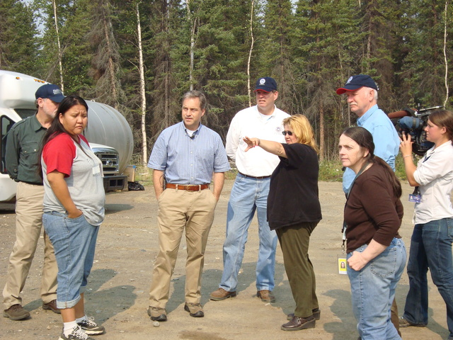 Flooding ^ Winter Storm - Eagle, Alaska, August 5, 2009 -- Alaska Governor Sean Parnell (center left) and Federal Coordinating Officer Doug Mayne (center right) learn about damages in Eagle resulting from the ice and flood damage received April 28 to May 31, 2009 from Eagle First Chief Joyce Roberts (left) and Eagle Tribal Administrator Donna Westphal. - Jack Heesch/FEMA