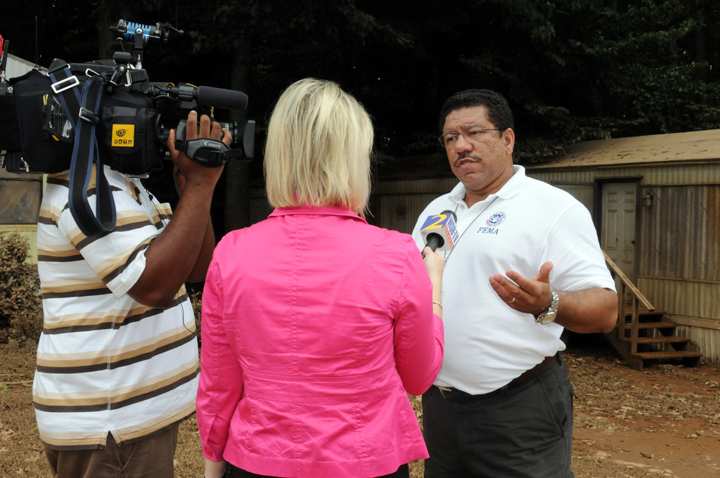 Flooding ^ Severe Storm - Austell, Ga. , September 24, 2009 -- At a Douglas County mobile home community, FEMA PIO William Lindsey speaks with a local television news crew. FEMA is here due to severe storms and flooding which totally covered the homes shown here(note mud lines on roof). George Armstrong, FEMA