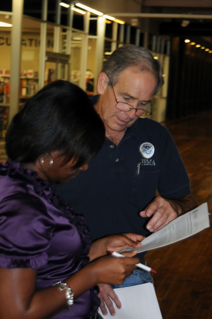 Flooding ^ Severe Storm - Austell, Ga. , Sep. 25, 2009 -- At the Georgia Emergency Management Agency/FEMA Cobb County Disaster Recovery Center (DRC), FEMA Public Information Officer (PIO) Jeff Welsh provides information to State Representative Alisha T. Morgan (Dist. 39). FEMA is here as result of recent severe storms and flooding.  George Armstrong/FEMA