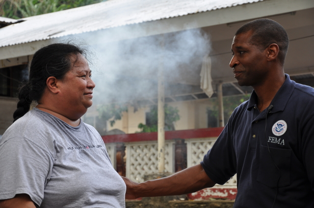 Earthquake ^ Flooding ^ Tsunami - Fagatogo, American Samoa, October 20, 2009 -- FEMA Federal Coordinating Officer Kenneth R. Tingman offers words of comfort to tsunami survivor Rose of Sharon, who lost a loved one and her harbor-side home to the disaster Sept. 29. Richard O'Reilly/FEMA