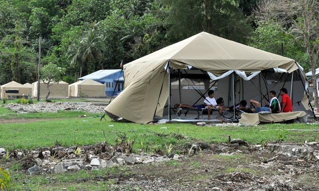 Earthquake ^ Flooding ^ Tsunami - Amanave, American Samoa, November 15, 2009 -- Large, strong new tents were well received in Amanave, which was the first location to receive the 16-by-16 foot tents designed to withstand the windy, rainy seasonal conditions now prevailing in American Samoa. They replaced smaller, dome style tents. Recipients praised the flexibility of the new tents. The walls can be raised or lowered as needed. The can be closed for privacy. Inside, they remained dry during torrential rain that began several hours after the tents were erected. Richard O'Reilly/FEMA.