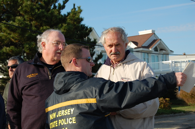 Severe Storm - Ocean City, N. J. , November 17, 2009 -- Frank McCall (Cape May County OEM Coordinator), Trooper Bill Craney (NJSP-OEM) and John Sadowski (FEMA) examine the damages from Tropical Depression Ida and nor'easter. Elissa Jun/FEMA