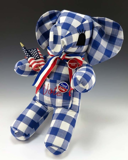 """Blue and White Gingham Stuffed Elephant With the Word """"Vote"""" Embroidered in Red"""