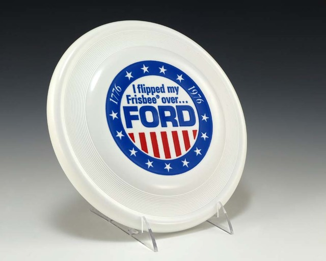 White Frisbee-Brand Flying Disc With Stars and Stripes Motif