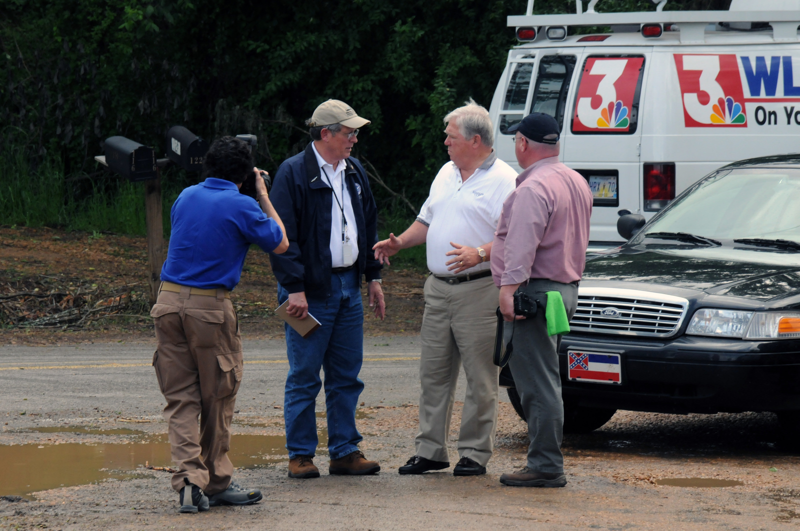 Severe Storm ^ Tornado - Lexington, Miss. , May 1, 2010 -- At the Ebenezer Community Volunteer Fire Station FEMA Federal Coordinating Officer Michael Bolch speaks with Governor Haley Barbour and his press secretary Dan Turner while being photographed by FEMA photographer David Fine. FEMA is here in response to the deadly April 24 tornado.  George Armstrong/FEMA