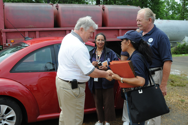 Severe Storm ^ Tornado - Lexington, Miss. , May 1, 2010 -- At the Holmes County Ebenezer fire station disaster staging area, Governor Haley Barbour greets FEMA Community Relations workers Noris Brown, Duane Marusa (lead), and Carmin Biggart. FEMA is here in response to the deadly tornado of April 24.  George Armstrong/FEMA