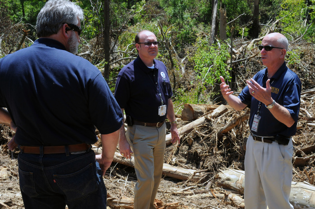 Severe Storm ^ Tornado - Yazoo City, Miss. , May 7, 2010 -- Mississippi Emergency Management Agency Public Assistance Deputy Officer Dan Munger(right) and FEMA Public Assistance Deputy Officer Sterling Bridges(2nd from left), and FEMA Public Assistance Manager John Robuck are on this site in the attempt to clarify an eligibility question raised by the Yazoo City Mayor in this morning's Public Assistance Applicant's Briefing. FEMA Public Assistance funds may assist local governments and localities recover costs incurred as result of the April 24 tornado.  George Armstrong/FEMA