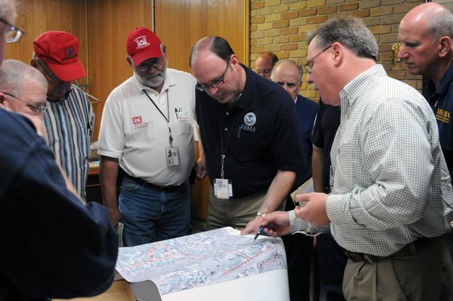 Severe Storm ^ Tornado - Yazoo City, Miss. , May 10, 2010 -- FEMA Deputy Public Assistance Officer Sterling Bridges(center), Mississippi Deputy PA Officer Dan Munger(right), Corps of Engineers Debris Subject Matter Expert Greg Williams(white shirt), and FEMA Debris Manager Danny McDowell(left) listen as City Engineer Wayne Morrison reviews a map of the county. FEMA Public Assistance funds can help local government and others eligible for PA funds recover expenses from the April 24 tornado. George Armstrong/FEMA