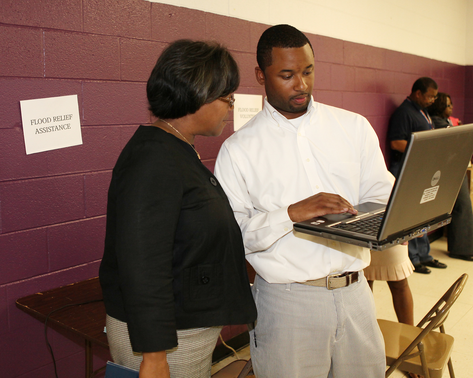 Flooding ^ Severe Storm - Bordeaux, Tenn. , May 11, 2010 -- Councilman-at-Large Jerry Maynard assists a Bordeaux resident with the FEMA disaster assistance website during a community meeting at the Temple Church of Christ.  FEMA is responding to the severe storms and flooding that damaged or destroyed many homes and businesses across Tennessee.  David Fine/FEMA