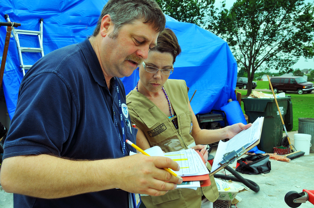 Severe Storm ^ Tornado - Tecumseh, Okla. , May 12, 2010 -- FEMA Individual Assistance Offricer John Nelson (left) and State of Oklahoma Individual Assistance Officer Amber Murphy confirm that both had the same findings following their inspection of a tornado-damaged home.  Three Preliminary Damage Assessment teams are inspecting tornado damages and losse in Oklahoma counties struck by 22 confirmed tornadoes on May 10.  FEMA Photo by Win Henderson