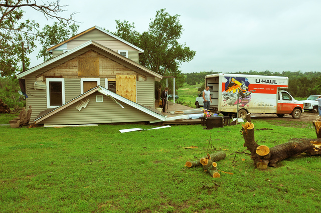 Severe Storm ^ Tornado - Tecumseh, Okla. , May 13, 2010 -- A homeowner salvages furniture and other household items that were spared by a tornado that struck his home on May 10.  The state experienced its fourth largest single-day outbreak - 22 confirmed tornadoes - in its history that day.  FEMA Photo by Win Henderson