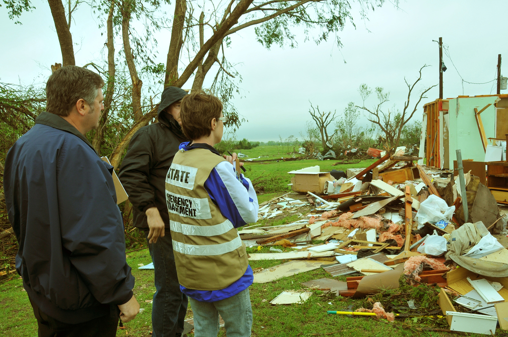 Severe Storm ^ Tornado - Tecumseh, Okla. , May 13, 2010 -- FEMA Individual Assistance Officer John Nelson (left) and Oklahoma Office of Emergency Management Indivdual Assistance Officer Amber Murphy (right) listen as a homeowner describes his family's harrowing ordeal on May 10th when his home and property were destroyed by a tornado. The state was struck by 22 confirmed tornadoes - including several F3 and two F4 storms -that day.  FEMA Photo by Win Henderson