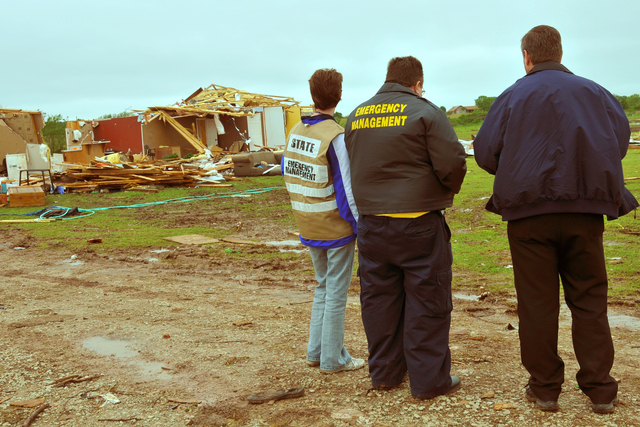 Severe Storm ^ Tornado - Tecumseh, Okla. , May 13, 2010 -- Three members of a Preliminary Disaster Assessment team - a State of Oklahoma individual assistance officer (left), the Emergency Manager of Pottawotamie County, and a FEMA individual assistance officer (right) - discuss their assessment of a home severely affected by a tornado.  Twenty-two tornadoes swept across a the eastern half of the state on May 10th.  FEMA Phoho by Win Henderson
