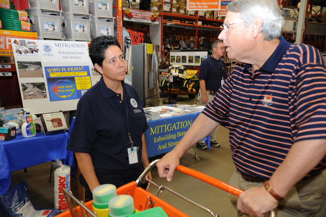 Flooding ^ Severe Storm - Jackson, Tenn. , June 1, 2010 --  FEMA Hazard Mitigation Adviser Carmen Rodriguez provides flood information to Michael Admas at a Jackson TN home improvement store. FEMA is responding to the severe storms and flood damages that affected the state of Tennessee in May 2010. Martin Grube/FEMA