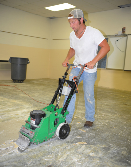 Flooding ^ Severe Storm - Waverly, Tenn. , July 13, 2010 -- Chris Fielder, a private contractor, strips damaged tile from the floor of Waverly Jr High School in Humphreys County TN caused by the severe storms and flooding that affected much of Tennessee in May 2010. FEMA provides funding to local and state agencies to recover from a disaster. Martin Grube/FEMA