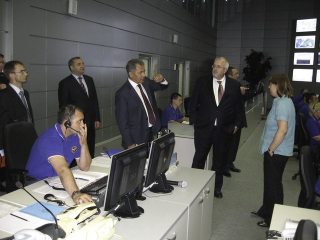 Moscow, July 22, 2010 -- Minister Sergey Shoigu, head of EMERCOM of Russia, gestures as he provides a tour to FEMA Administrator W. Craig Fugate of EMERCOM's National Crisis Management Center in Moscow, Russia.