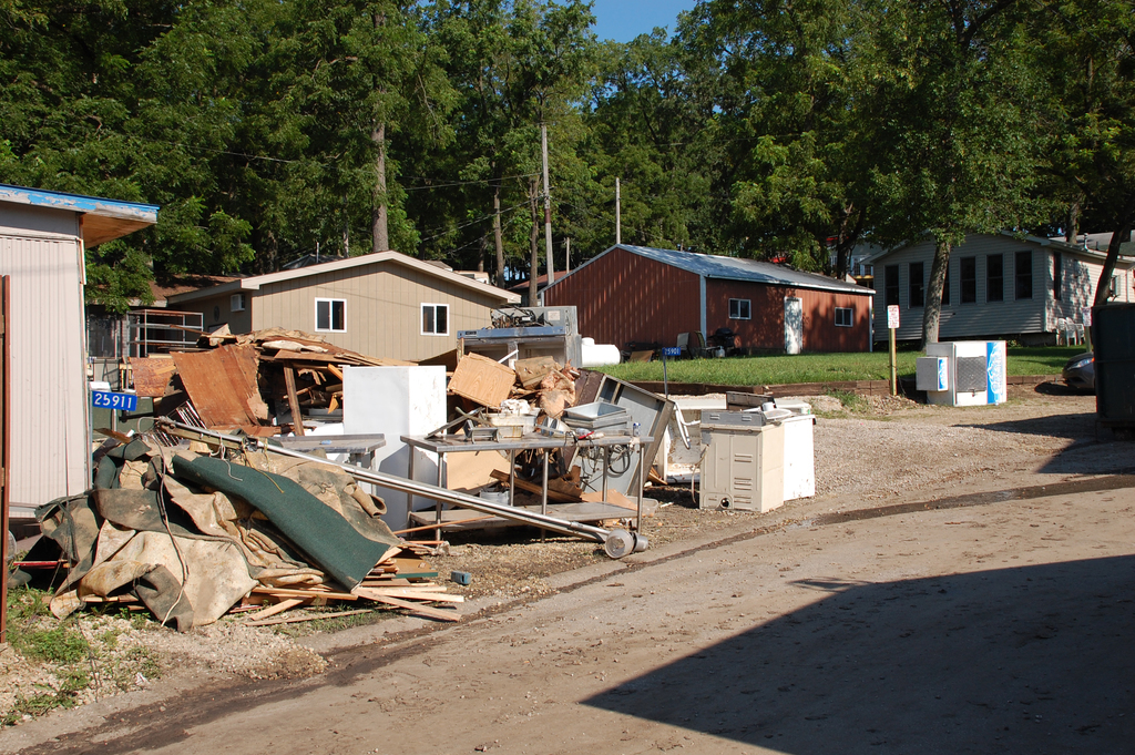 Flooding - Lake Delhi, Iowa, July 29, 2010 -- What was once the contents of a home sit along the road in Lake Delhi, Iowa. Record or near record rainfall caused area homes to flood and the Lake Delhi Dam to fail. The recovery has started with the preliminary damage assessment process headed by FEMA and the state of Iowa.  Jace Anderson/FEMA