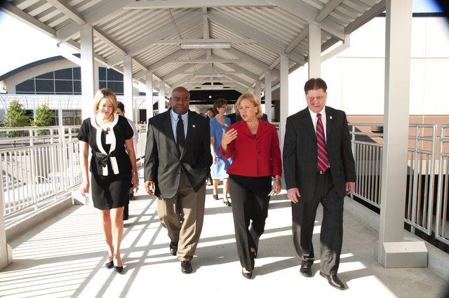 Hurricane/Tropical Storm ^ Severe Storm - Slidell, La. , August 25, 2010 --Tony Russell, FEMA's Region 6 Administrator(l)along with Senator Mary Landrieu,D-LA and Trey Folse(r), St. Tammany's Superintendent of Schools walk along one of the new covered through ways at Salmen High School. FEMA provided funding for the rebuild school.  Photo by Patsy Lynch/FEMA