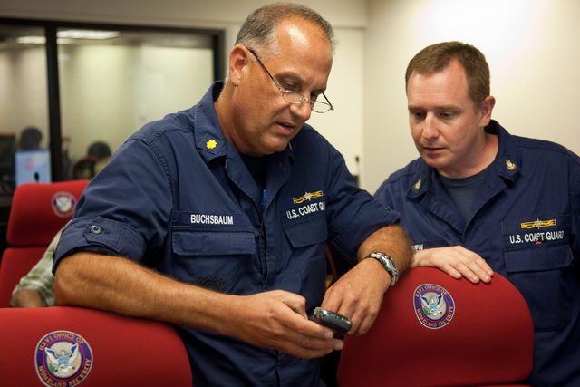 Flooding ^ Hurricane/Tropical Storm ^ Severe Storm - St. Thomas, US Virgin Islands, August 30, 2010 -- Coast Guard Marine Safety Supervisor, LCDR Daniel Buchsbaum looks at an updated situation report on Hurricane Earl on his blackberry with Coast Guard Marine Science Technician Chief James Carew at the Virgin Islands Territorial Emergency Management Agency (VITEMA)  Emergency Operations Center in St. Thomas. Andrea Booher/FEMA
