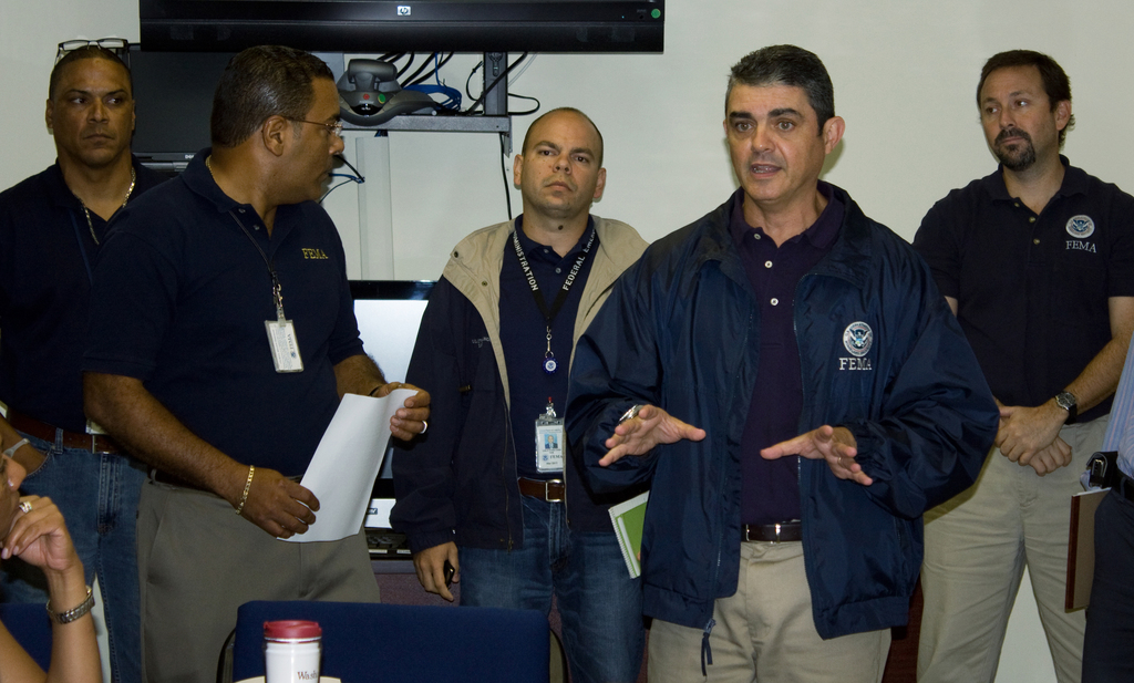 Hurricane/Tropical Storm - San Juan, Puerto Rico, August 30, 2010 --  Caribbean Area Division Director, Alejandro De La Campa and FCO Justo Hernandez, address staff at the CAD.  They imparted instructions on how to prepare for Hurricane Earl.  Photo by Yuisa Rios/FEMA