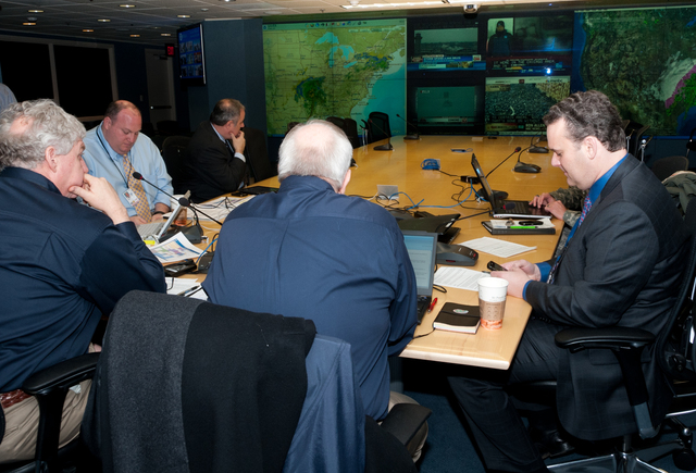 Winter Storm - Washington, D. C. , February 1, 2011 -- Senior officials from FEMA, including Administrator Craig Fugate (center, back to camera), Deputy Administrator Rich Serino (left) and Chief of Staff Jason McNamara (right), joined via telephone by DHS Secretary Janet Napolitano, brief President Obama via teleconference on the winter storm that is affecting a large portion of the country. FEMA/Aaron Skolnik