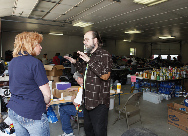 Tornado - Snow Hill, N. C. , April 19, 2011 -- Debra Miller, NC Emergency Management speaks to Pastor Tony Calhoun (r) at a survivor donation center in Snow Hill.  FEMA is responding to severe storms and deadly tornadoes that damage or destroyed homes and businesses across North Carolinavon April 16, 2011. David Fine/FEMA