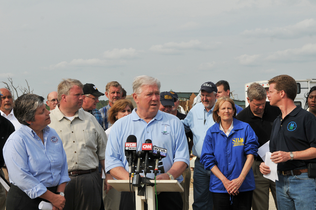 Tornado - Smithville, Miss. , May 1, 2011 -- Mississippi Governor Haley Barbour speaks at a press conference in Smithville MS, a small community hit hard by an F5 tornado April 27th. DHS Secretary Janet Napolitano (left) listens, along with FEMA Administrator Craig Fugate ( back to the right), SBA Administrator Karen Mills (right), Secretary of Agriculture Tom Vilsack ( black shirt,behind right), and HUD Secretary Shaun Donavan (blue shirt, far right).  FEMA photo / Tim Burkitt