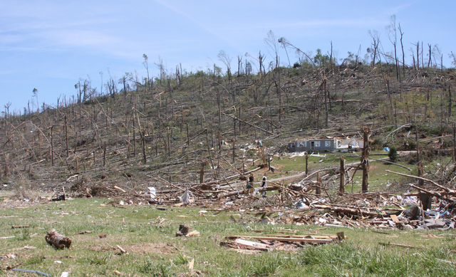 Tornado - Ringgold, Ga. , May 5, 2011 -- A scorched hillside, and what's left of a house, in Catoosa County, after a tornado swept through on April 27, 2011.  President Obama declared the county a Major Disaster on April 29.  Judith Grafe/FEMA Photo