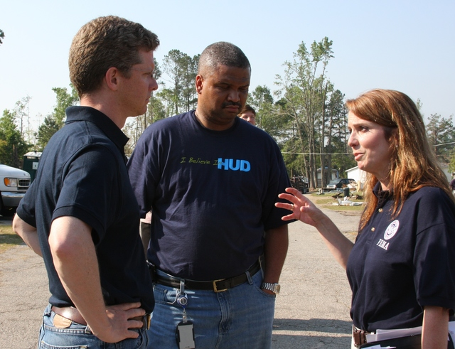 Tornado - Griffin, Ga. , May 10, 2011 -- Secretary of the Department of Housing and Urban Development (HUD) Shaun Donovan (Left) is briefed on FEMA's response to the damage at the Ponderosa Mobile Home Park near Griffin, Ga.  With him is HUD Regional Administrator Ed Jennings, Jr. , and FEMA Federal Coordinating Officer Gracia Szczech.  The area was severely damaged by a tornado on April 27, 2011.  Judith Grafe/FEMA Photo