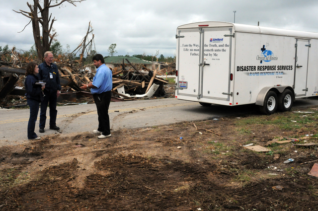 Severe Storm ^ Tornado - Phil Campbell, Ala. , May 14, 2011 --  FEMA Community Relations Specialists Laura Philpot and Tom Violette speak with Mike Yoder of the Christian Aide Ministries Disaster Service Rapid Response Team of Tennessee. Faith based organizations like this provide critical immediate services to storm survivors and are FEMA partners in recovery efforts for those affected by the April tornado. George Armstrong/FEMA
