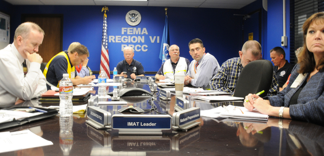 Emergency Planning and Security - Denton, Texas, May 17, 2011 -- FEMA Region VI staff in the Regional Response Coordination Center (RRCC) Conference Room listen during a Videoteleconference on National Level Exercise 11. FEMA/Earl Armstrong
